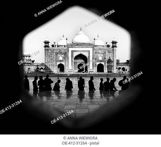 Silhouette of people facing the Taj Mahal, Agra, India