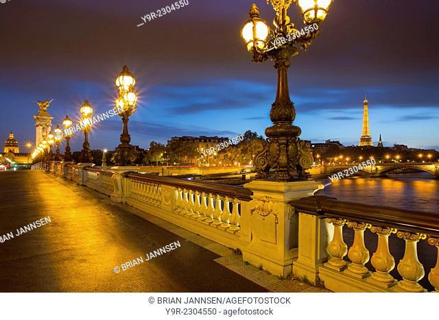 Twilight along Pont Alexandre III over River Seine, Paris, France