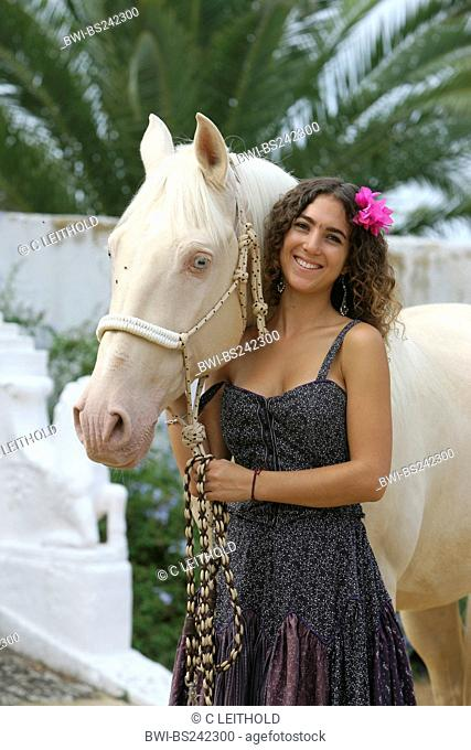 Andalusian horse Equus przewalskii f. caballus, young woman with Andalusian horse, Spain, Andalusia