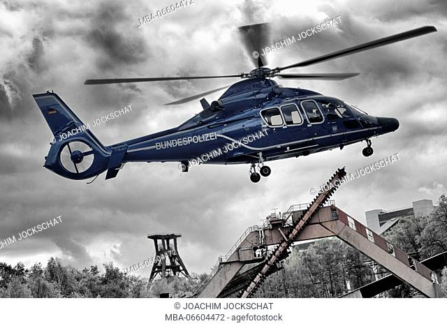 Transport helicopter EC 155 B of the federal police while take-off on Zollverein Coal Mine Industrial Complex, Essen, North Rhine-Westphalia, Germany [M]