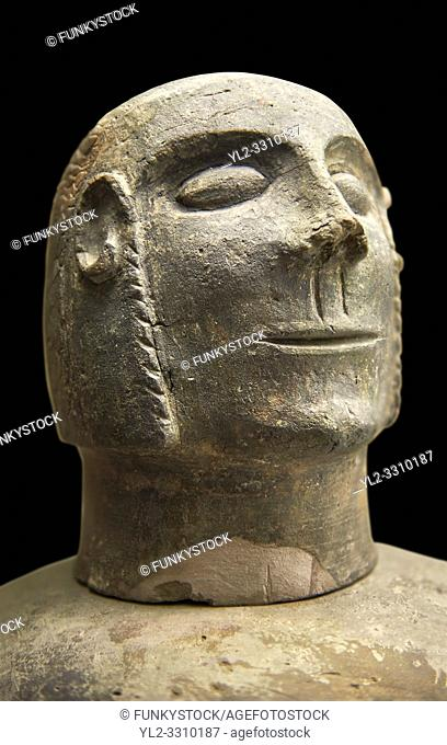 Close up of an end of 7th to start of 6th century B. C Etruscan lid in the shape of a head of a Canopo style vase, used to hold funereal ashes from Chiusi