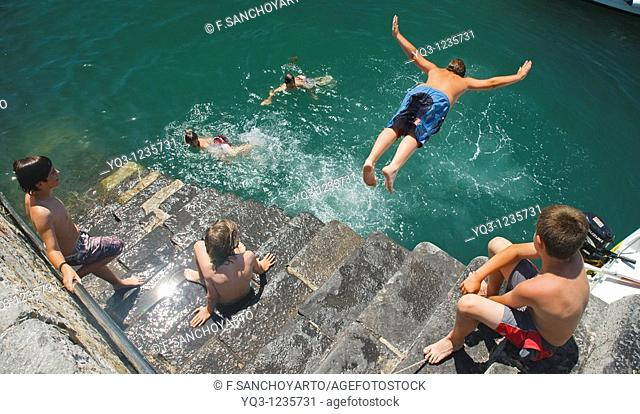 Children diving in, Castro Urdiales, Cantabria, Spain