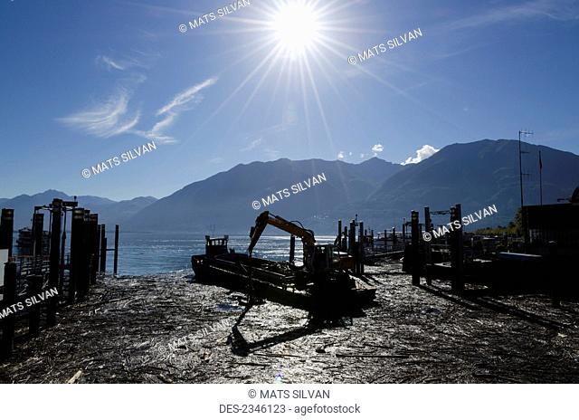 Industrial equipment on the shore of Lake Maggiore on a sunny day; Locarno, Ticino, Switzerland