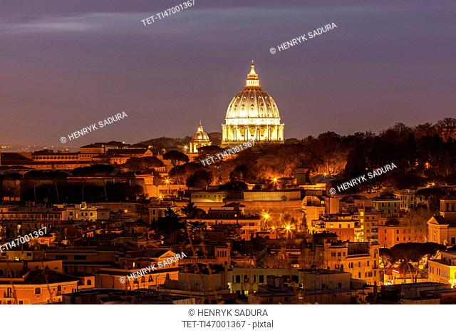 Illuminated St. Peter's Basilica at dusk