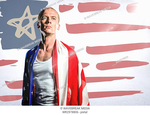 Man wrapped in american flag against hand drawn american flag and white wall with flare