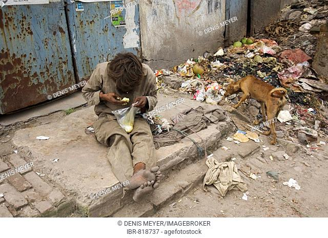 A homeless person on the streets of Topsia, people who can only sustain themselves through begging and scrounging through others garbage no longer fit the image...
