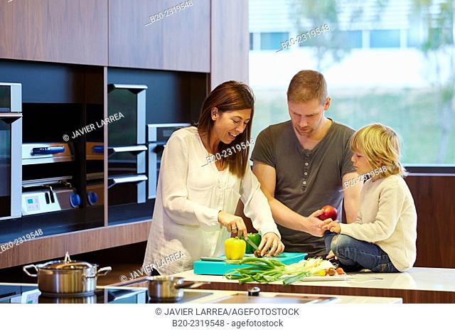 Family in the kitchen. Parents and son. Healthy eating. Healthy growth. Vegetables and fruits
