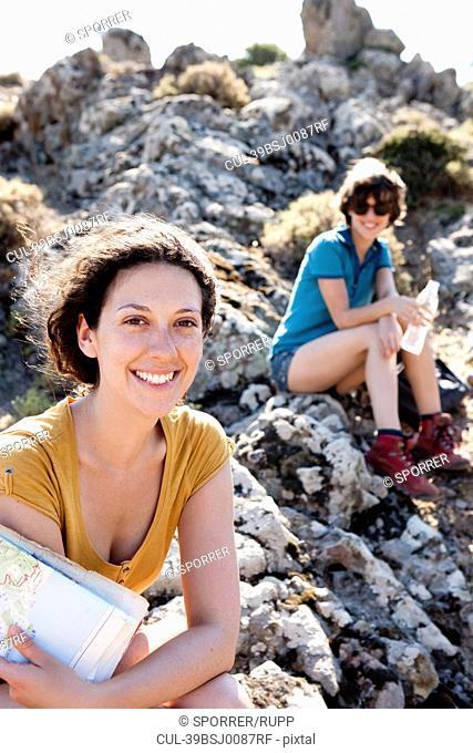 Hikers resting on rocks