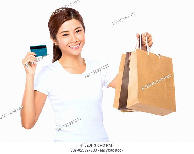 Young woman hold with shopping bag and credit card