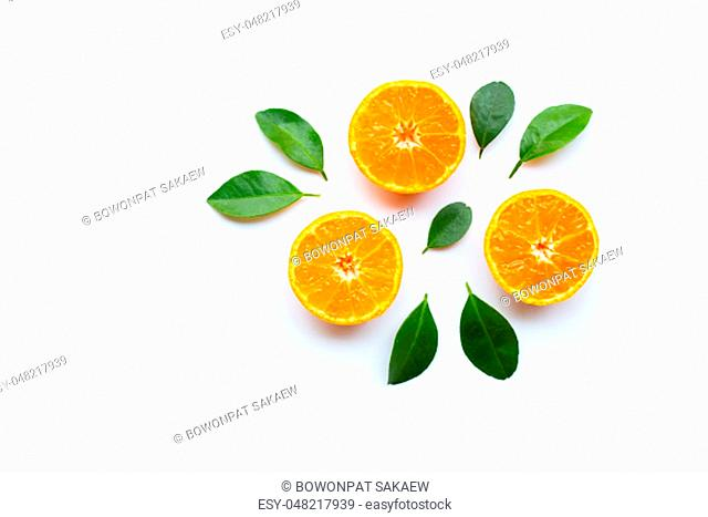 Orange fruits with leaves on white background. Copy space