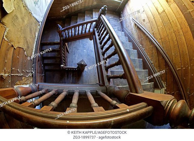 Interior of an old staircase in an abandoned Victorian era home, 1887, Calvert, Texas
