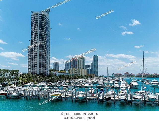 Moored yachts and condos in Miami Beach South Pointe, Florida, USA