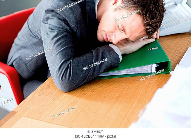 Man sleeping on a file