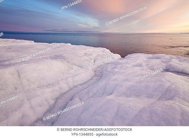 glacier Brasvellbreen and Arctic Sea in sunset light, Nordaustlandet, Svalbard