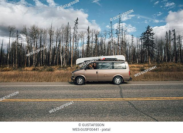 Canada, British Columbia, man with minivan on Alaska Highway