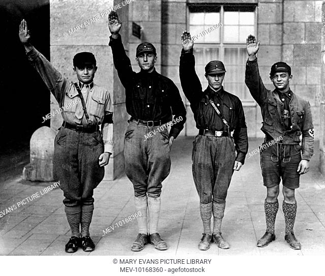 Young German men, fascists, giving the Nazi salute