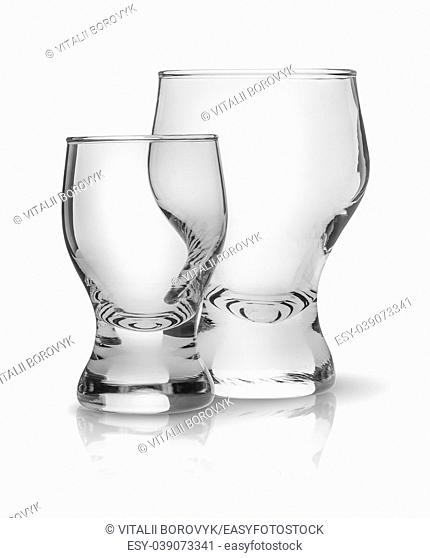 Two glasses side by side. Big and small glasses one after another. Isolated on white background