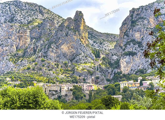 panorama of village Moustiers-Sainte-Marie at foot of mountainscape, Provence, France, member of most beautiful villages of France