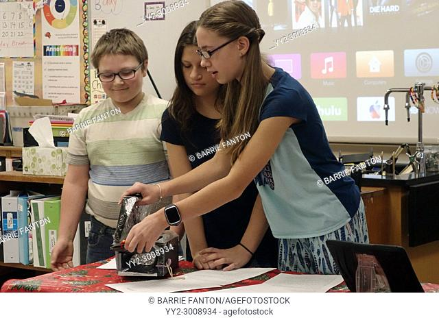 6th Graders Preparing Solar Powered Cooker, Science Project, Wellsville, New York, USA