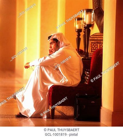 Arab man using a mobile phone