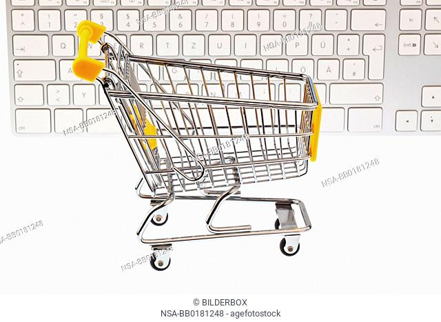 A shopping cart and computer keyboard.symbolic of shopping on the Internet and Oline-shopping