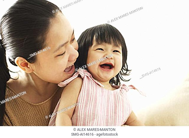 Mother and baby girl, smiling