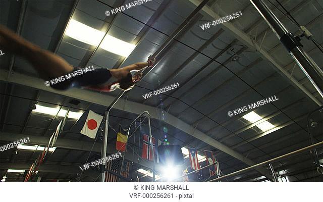 WS Girl (12-13) performing gymnastics on high bar / Lindon, Utah, USA