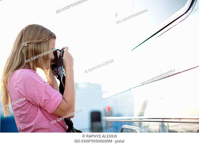 Woman taking picture of reflection