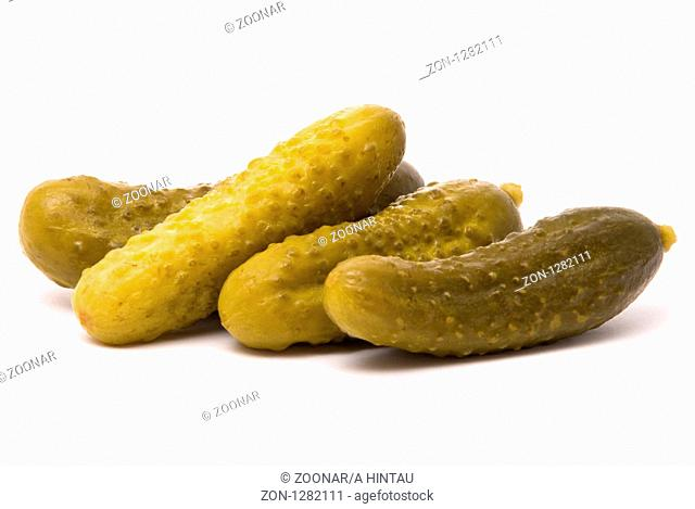 Salted cucumbers on a white background