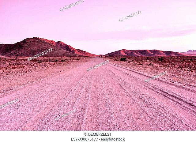 Sunset on the gravel road in the NamibRand Nature Reserve in Namibia