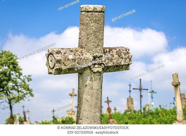 Abandoned cemetery near ruined castle in former Chervonohorod village in Zalischyky region, Ternopil Province, Ukraine