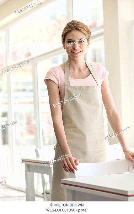 Smiling waitress in restaurant