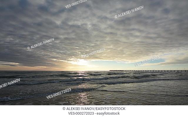 Sunset over the sea, the surf, the beautiful sky, the Black Sea, Anapa, Russia