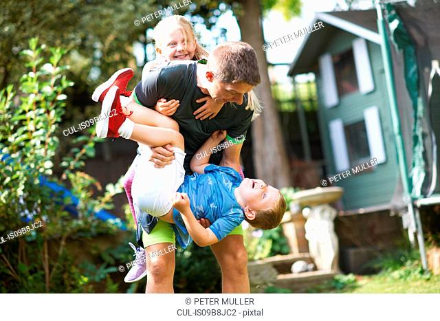 Family playfighting in garden