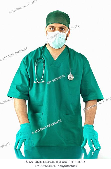 Handsome young surgeon on white background