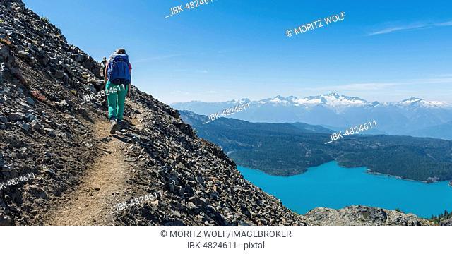 View from Panorama Ridge Hiking Trail, Hiker at Garibaldi Lake, Turquoise Glacial Lake, Guard Mountain and Deception Peak, Garibaldi Provincial Park