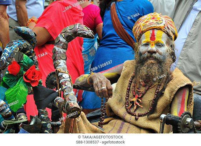 Sadhu on the wheel chair on the day of the Gai Jatra festival