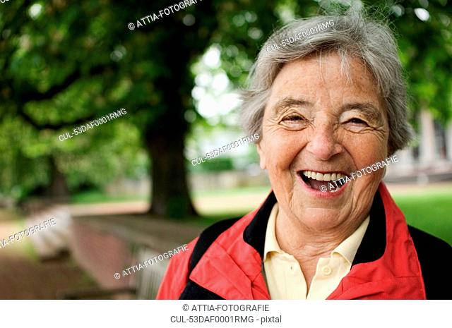 Older woman laughing in park