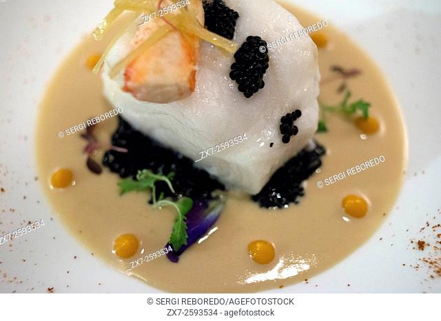 Thai food dish at L'APPART SOFITEL SUKHUMVIT. Pan fried cod fish, coco beurre blanc, caviar lemon and crushed potato (990)