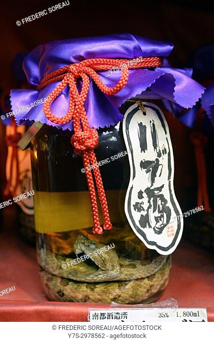 Okinawan Snake Wine or Habushu on display in one of the many tourist souvenir shops on kokusai Dori , Naha,Okinawa island,Japan,Asia