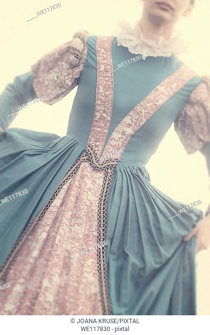 young, beautiful woman in a renaissance dress