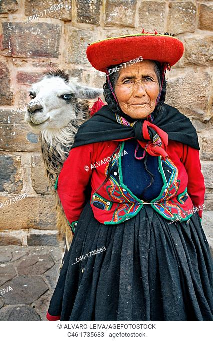Woman with llama dressed on traditional dress, Cuzco, Peru