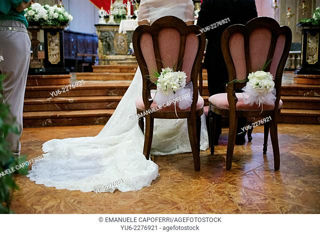 Bride and groom at the altar of the church
