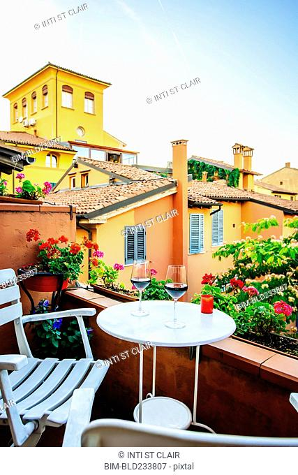 Wine glasses on balcony, Bologna, Emilia-Romagna, Italy