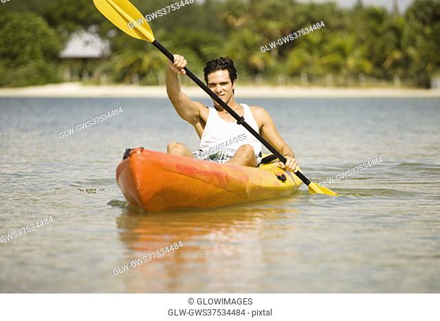 Portrait of a young man kayaking
