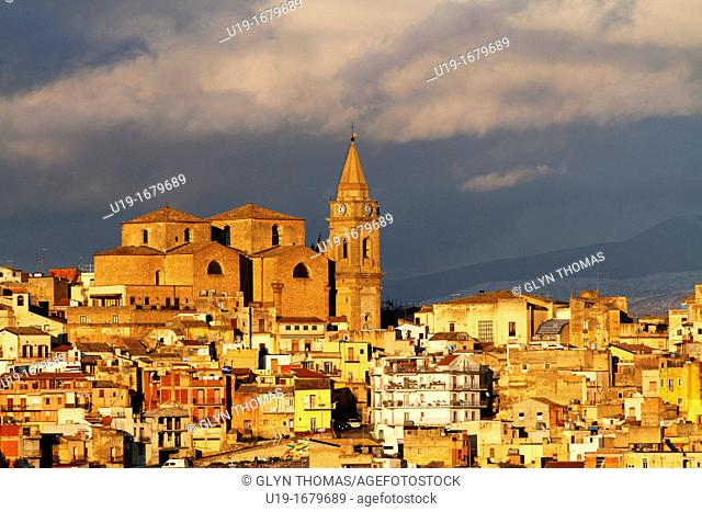 Regalbuto, town in the province of Enna, and the Chiesa Madre San Basilio with a stormy sky behind, Sicily, Italy