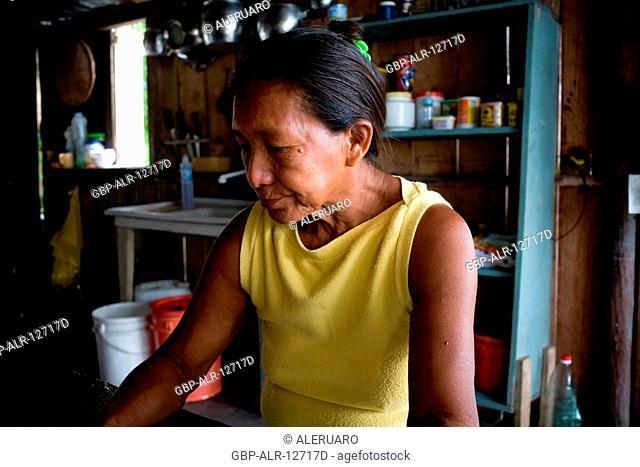 Seating woman, Cuieiras River, Amazônia, Manaus, Amazonas, Brazil