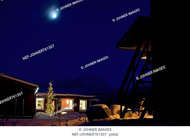 Mountain lodge under a night sky, Lapland, Sweden