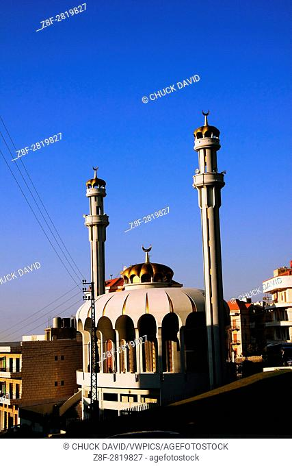 A very unusually shaped and designed mosque with crowns on its dome and minarets in the south of Beirut, Lebanon