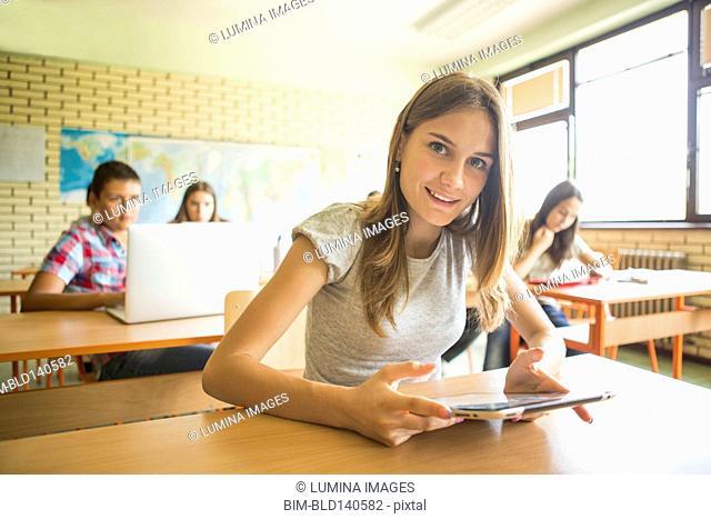 Student using digital tablet in classroom